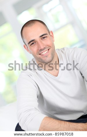 Handsome guy relaxing in sofa - stock photo