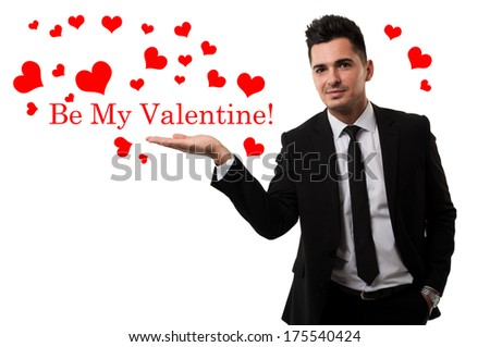 Handsome guy sending love in the shape of red hearts - stock photo