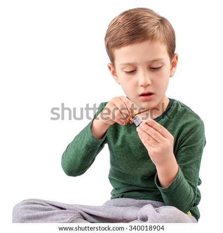 Handsome guy who is playing and building something with toys - stock photo