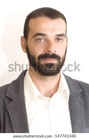 Handsome guy with beard and jacket on white background