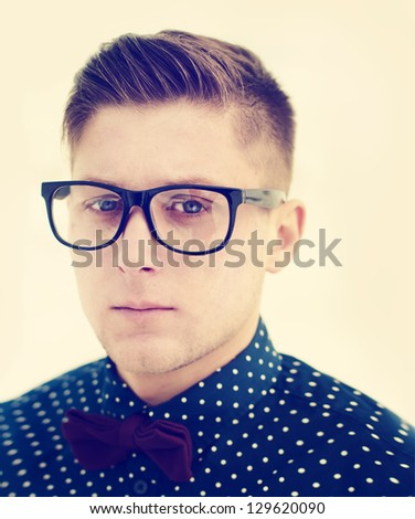 handsome guy with glasses and a fashionable hairdo. vintage photo - stock photo