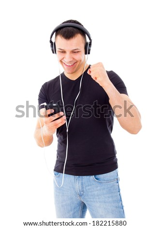 handsome guy with headphones succeeds to run play list on mobile phone