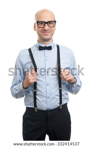 Handsome guy with suspenders and bow-tie. Studio shot