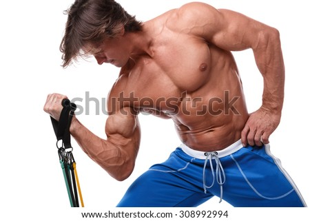 Handsome guy working out with rubber band over white background - stock photo