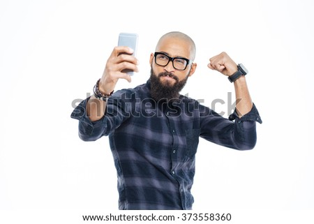 Handsome hairless african american man with beard showing biceps and making selfie - stock photo