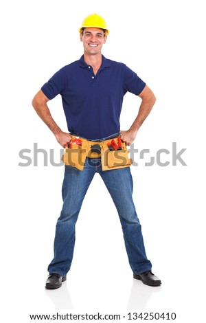 handsome handyman wearing tool belt and helmet over white background - stock photo