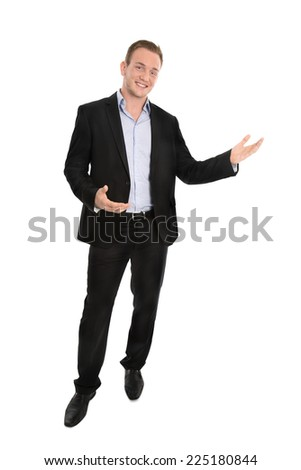 Handsome happy isolated young businessman presenting with hands over white background. - stock photo
