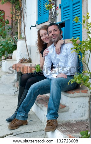 Handsome happy man and young woman - stock photo