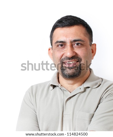 Handsome & happy middle aged mature indian adult business man looking with satisfaction and happiness. The person is looking relaxed with causal attire & photo is shot in studio with white background - stock photo