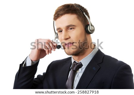 Handsome happy smiling customer support phone operator. - stock photo