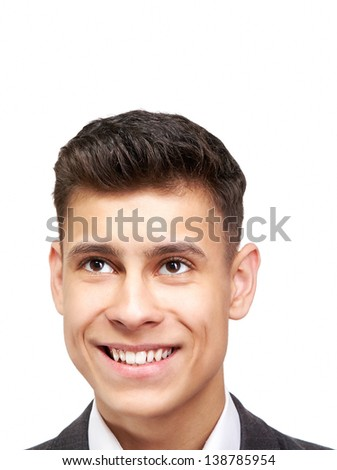 Handsome happy young man looking up over white background - stock photo