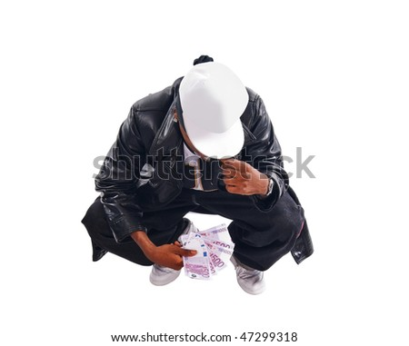 Handsome hip-hop young man with cash isolated on white background