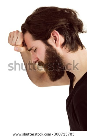 Handsome hipster feeling depressed on white background