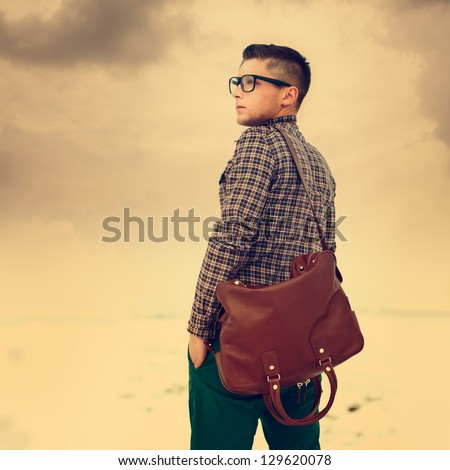 handsome hipster guy with a bag. vintage photo - stock photo