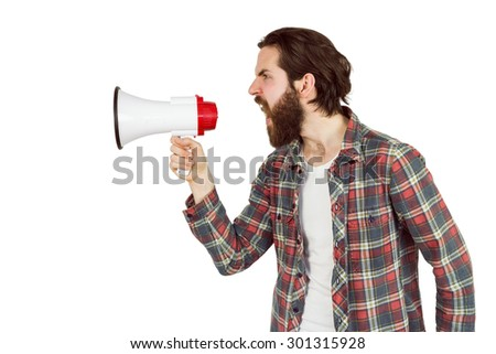 Handsome hipster shouting through megaphone on white background - stock photo