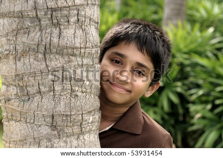 handsome indian kid looking eagerly to the camera - stock photo