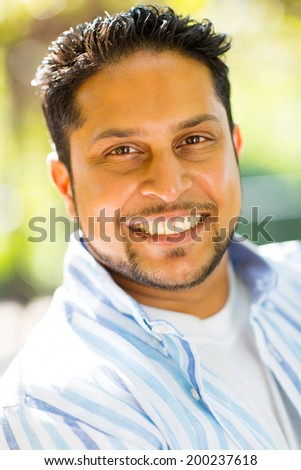 handsome indian man close up portrait outdoors - stock photo