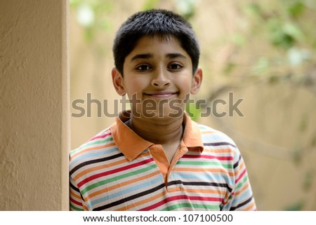 Handsome Indian toddler standing outdoor thinking