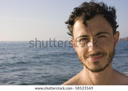 Handsome italian man at the beach of Monte Ruiu, Sardinia, Italy - stock photo