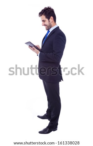 Handsome latin business man with tablet computer, isolated on a white background - stock photo