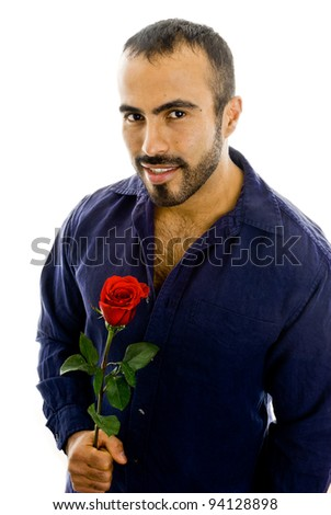 Handsome latin man holding a rose