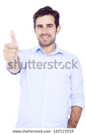 Handsome latin man thumbs up over a white background - stock photo