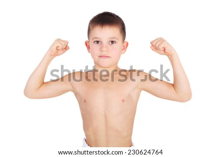 handsome little boy demonstrating his muscles