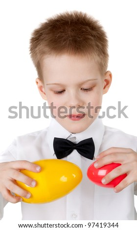 handsome little boy playing with the easter eggs