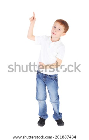 handsome little boy pointing up - stock photo
