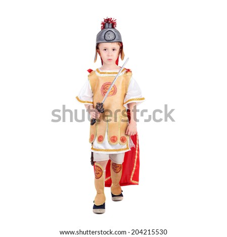 handsome little kid in the costume of the roman legionary - stock photo