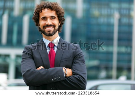 Handsome male manager outdoor - stock photo