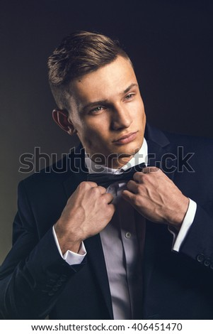 Handsome male model in suit tie bow - studio shot