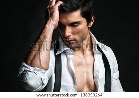 Handsome male model touching his head. - stock photo