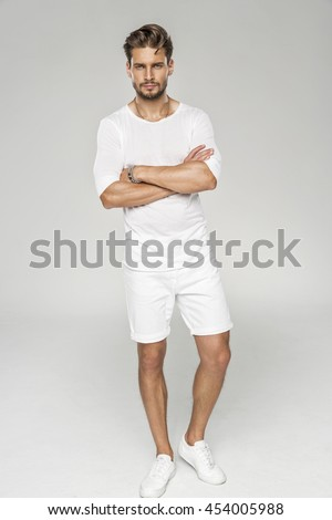 Handsome male model with arms crossed wear white clothes