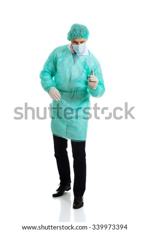 Handsome male surgeon doctor doing an injection. - stock photo
