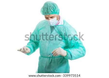 Handsome male surgeon with a scalpel. - stock photo