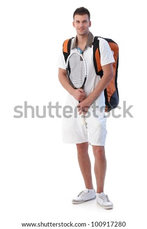 Handsome male tennis player going for training, holding tennis racket, smiling. - stock photo