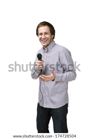 Handsome male with microphone posing on white background