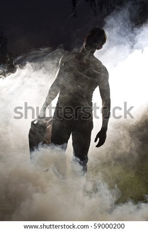 handsome man and abstract smoke - stock photo
