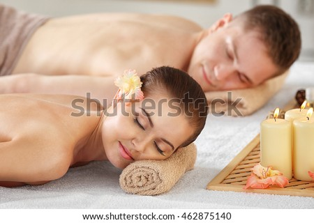 Handsome man and beautiful girl relaxing in spa salon