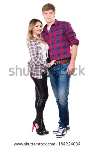 Handsome man and pretty woman posing in checked shirts. Isolated on white - stock photo