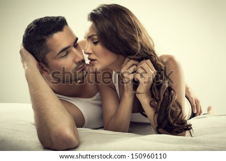 Handsome man and sexy woman in bed - stock photo