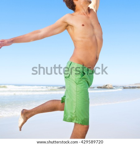 handsome man at the beach - stock photo