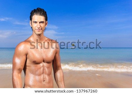 Handsome man at the Paradisiac beach in Phuket Thailand