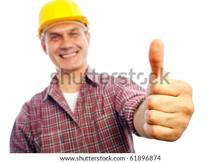 handsome man builder smiles and shows a gesture OK - stock photo