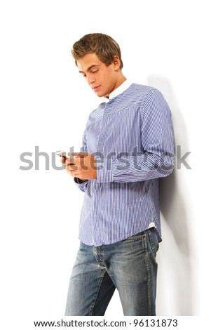Handsome man calling on mobile phone - stock photo
