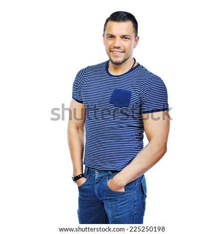 Handsome man casually posing with hands in a pockets - stock photo