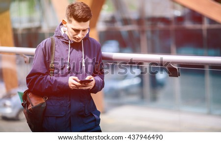 Handsome man cell phone call smile outdoor city street, Young attractive guy casual blue shirt use smartphone - stock photo