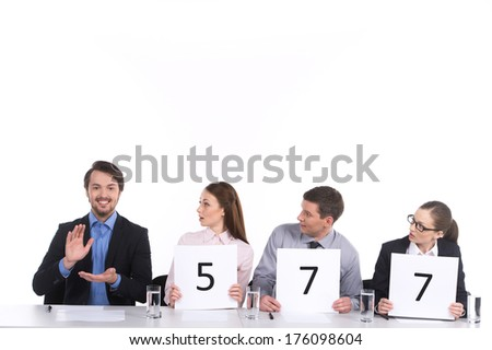 handsome man clapping and other watching. three persons surprised watching one - stock photo