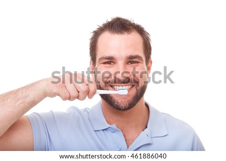 Handsome man cleans teeth, isolated on white
